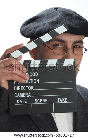 Old fashioned man looking through the movie clapper - stock photo