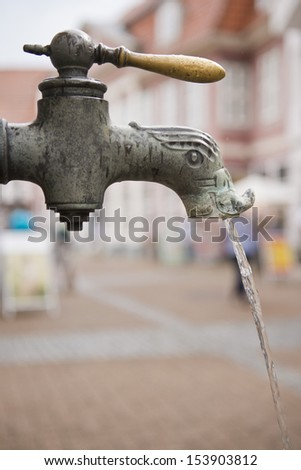 old fashioned metal  tap running - stock photo