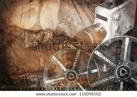 Old fashioned movie cam and film reels - stock photo