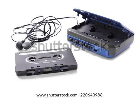 old-fashioned music cassette and walkman with earphones - stock photo