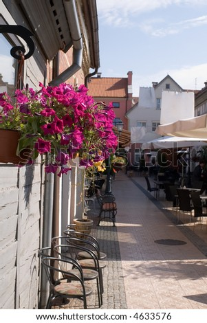 old fashioned pedestrian passage with cafes - stock photo