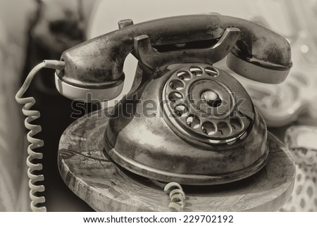 Old-fashioned phone isolated on a blurred background. - stock photo