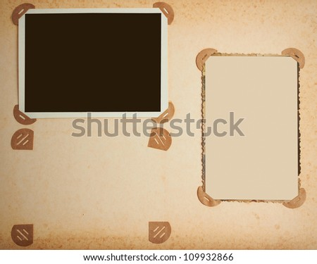 old-fashioned photo frames in vintage album - stock photo