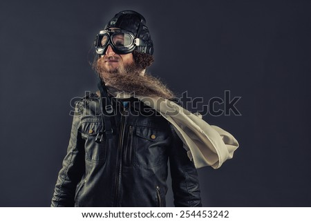 Old fashioned pilot with goggles and a scarf