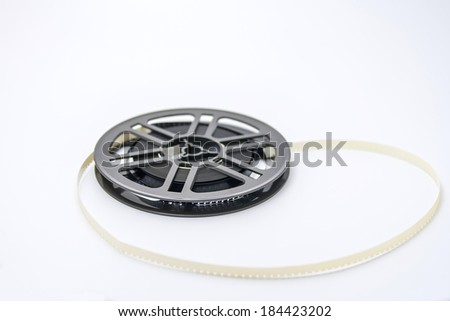 Old fashioned plastic film reel with 8 mm film - stock photo