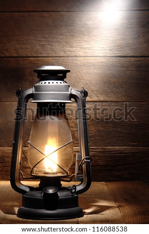 Old Fashioned Rustic Kerosene Oil Lantern Lamp Burning With A Soft Glow Light In An Antique