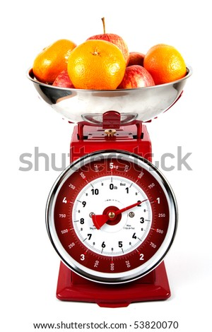 Old Fashioned scales with oranges and apples - stock photo