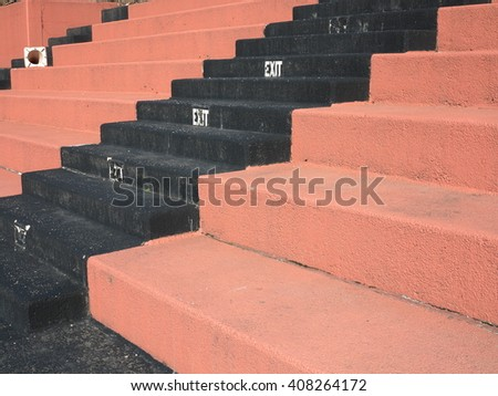 Old Fashioned Sports Seating - Hard concrete bleacher seats in an outdoor sports facility. - stock photo
