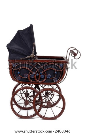 Old fashioned stroller. Taken on white background. - stock photo