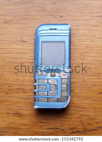 Old fashioned style mobile phone - stock photo