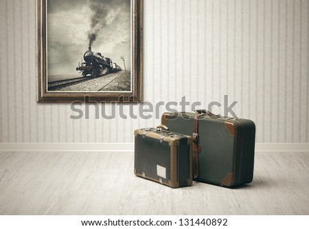 Old-fashioned suitcases alone in a train station. - stock photo