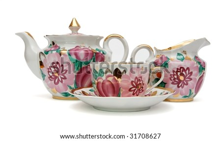 Old-fashioned tea service with floral pattern isolated