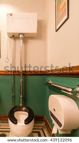 Old Fashioned Toilet in Small Bathroom - stock photo