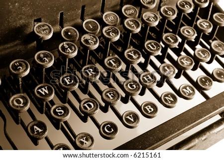 Old-fashioned typewriter sepia cast - stock photo