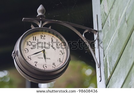 Old fashioned wall clock showing the time at the station - stock photo