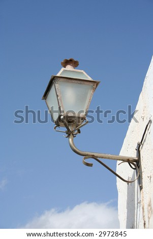 Old fashioned, wall mounted street lamp in Teguise, Lanzarote