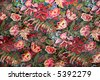 Old fashioned wallpaper with an intense floral design. - stock photo