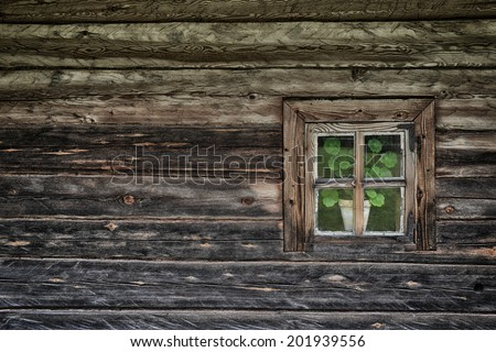 Old-fashioned window of wooden house