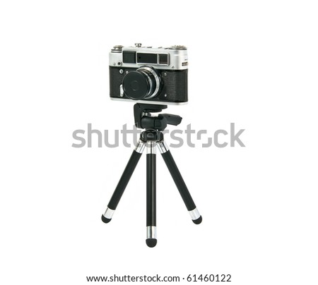 Old Fed 4 camera on tripod isolated on white