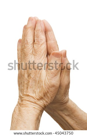 Old female hands pray isolated on white