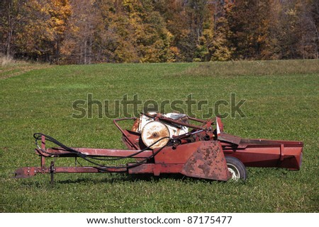Old field machine - seen in Wisconsin, USA - stock photo