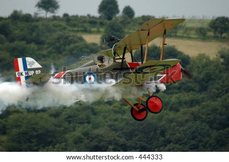 old fighter plane with smoke