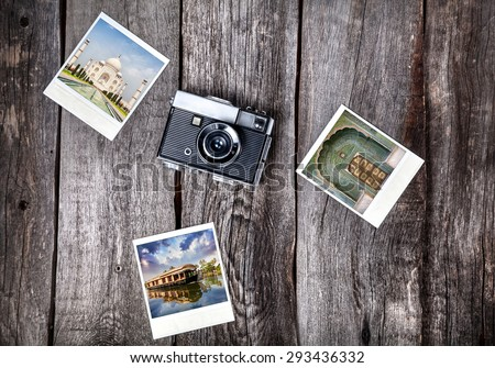 Old film camera and polaroid photos with Indian famous landmarks on the wooden background - stock photo