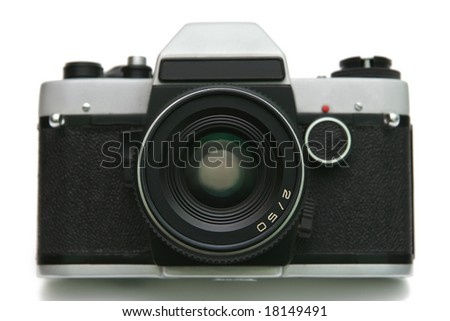 Old film camera on white background.