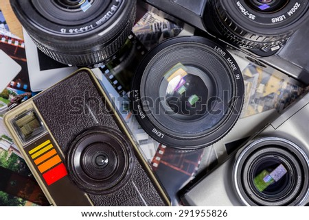 Old  film  cameras with negatives, slides and film - stock photo