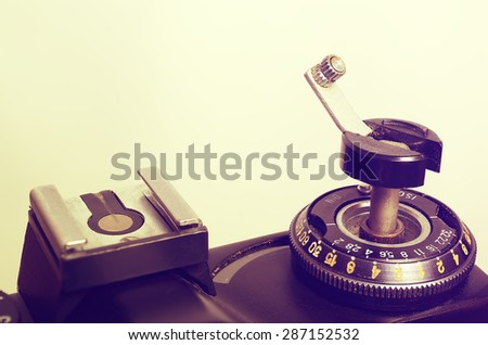 Old film DSLR camera. The dial sensitivity of the film. Rewinding the film. Index of the exposure meter. Close up view. Macro. Top view. Selective focus. Vintage photo. Toning. - stock photo