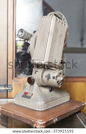 old film projector film - stock photo