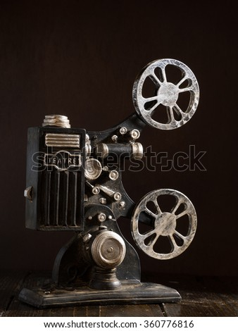 Old film projector with dark background - stock photo