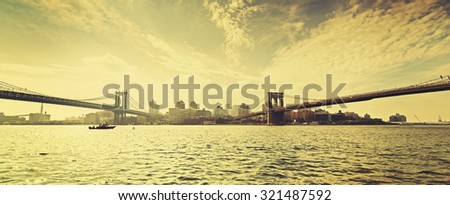 Old film retro style New York waterfront view with famous Brooklyn and Manhattan Bridges, USA. - stock photo