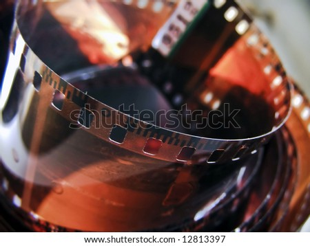 Old film rolled - stock photo