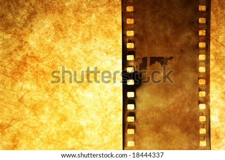 Old film strip over grunge paper background - stock photo