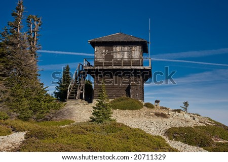 Old fire lookout station in the mountains - stock photo