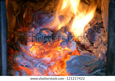 Old fireplace, stove, fire - stock photo