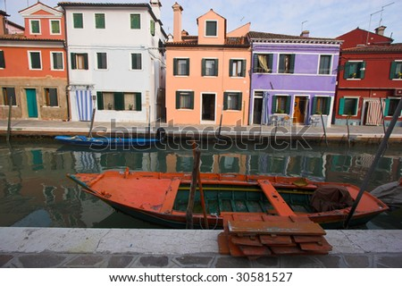 Old fisherman boat moored in Burano canal