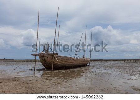 old fisherman boat on beach and mud when low level water