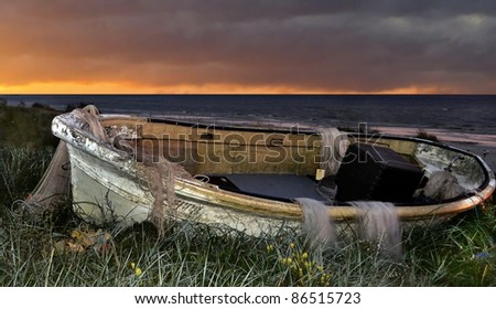 Old fishing boat and nets - stock photo