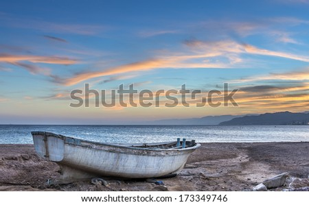 Old fishing boat beached at the Red Sea - stock photo