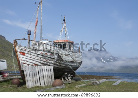 Old fishing boat in Strandir, Iceland - stock photo