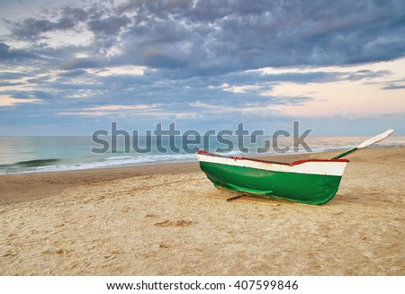 Old fishing boat on beach of the Baltic Sea - stock photo