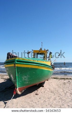 Old fishing boat on the beach - stock photo