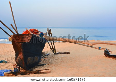 Old fishing boat on the beach of Goa, India - stock photo