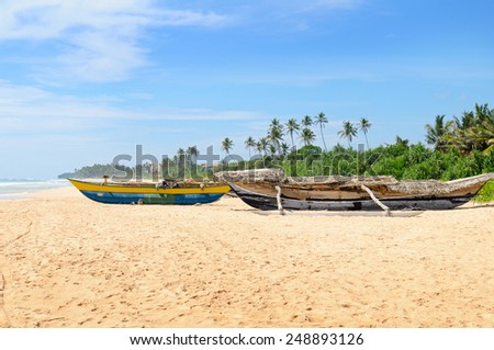 old fishing boat on the sandy shore - stock photo
