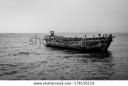 Old fishing boat with Sanctuary Birds over sea