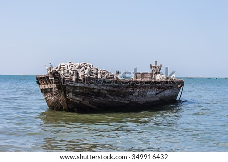 old fishing boats in sea. - stock photo
