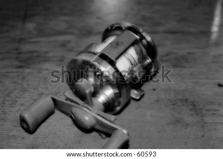 Old Fishing Reel - stock photo