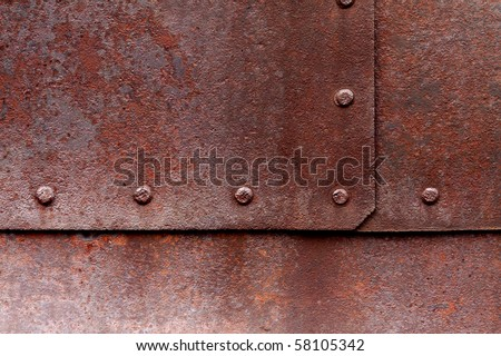 Old flat metal with pitting, rust and rivets. - stock photo